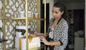 Jomana Siddiqui, founder of ModernEid, organizes ModernEid product displays at her office in Fullerton, California.